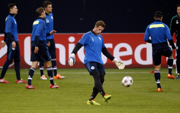 Schalke 04's goalkeeper Faehrmann kicks a ball during a training session in Gelsenkirchen