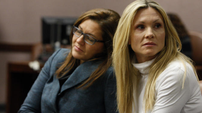"Attorney Ellen Torregrossa-O'Connor, left, holds the hand of  former ""Melrose Place"" actress Amy Locane-Bovenizer, 40, of Hopewell Township, N.J. as the jury in her trial returns a verdict on Tuesday, Nov. 27, 2012 in Somerville, N.J.   The jurors convicted Locane-Bovenizer of vehicular homicide, but acquitted her of a more serious charge, aggravated manslaughter, in the 2010 accident that killed a 60-year-old woman. Somerset County prosecutors said Locane-Bovenizer's blood-alcohol level was nearly three times the legal limit when the crash occurred on a dark two-lane road in Montgomery Township. The defence conceded she was driving under the influence. But her lawyer claimed a woman was chasing her after an earlier accident, forcing her to speed.  (AP Photo/The Star-Ledger, Robert Sciarrino, Pool)"