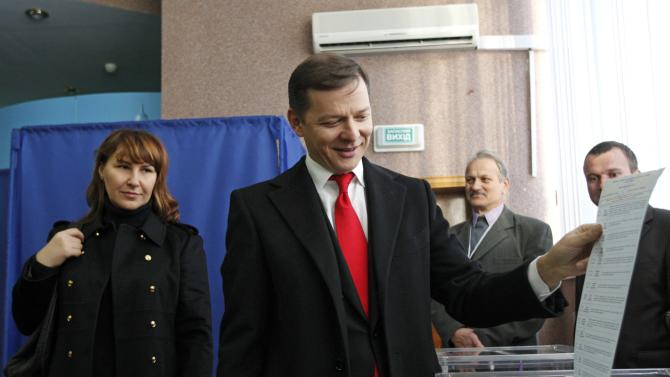 Oleh Lyashko, head of the Radical Party, casts a ballot as he visits a polling station during a parliamentary election in Kiev
