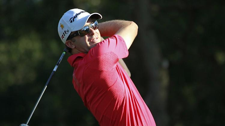 Martin Laird, of Scotland, hits from the ninth tee during the first round of the Players Championship golf tournament on  Thursday, May 10, 2012, at Sawgrass in Ponte Vedra Beach, Fla. (AP Photo/John Raoux)
