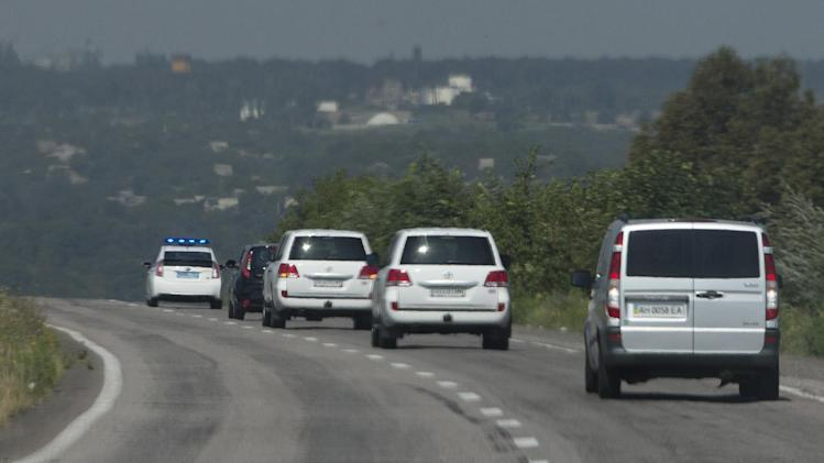 Convoy of the OSCE mission in Ukraine travel outside the city of Donetsk, eastern Ukraine Wednesday, July 30, 2014 as they try to estimate security conditions. (AP Photo/Dmitry Lovetsky)
