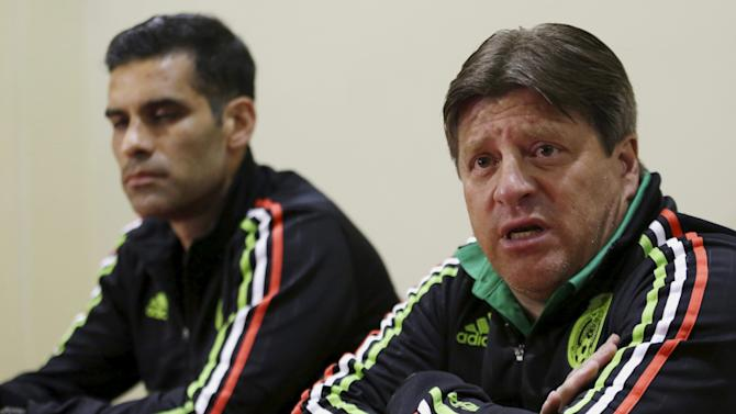Mexico's national soccer coach Miguel Herrera and player Rafa Marquez address a news conference in Lima