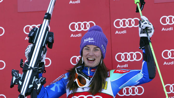 Tina Maze from Slovenia, reacts on the podium after winning the women's World Cup giant slalom race in Aspen, Colo., on Saturday, Nov. 24, 2012. (AP Photo/Alessandro Trovati)