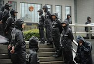 Police stand guard outside the Intermediate People's Court in Hefei, Anhui province. Gu Kailai -- the wife of disgraced Chinese politician Bo Xilai -- did not deny murdering a British man during her one-day trial that ended with no verdict in Hefei