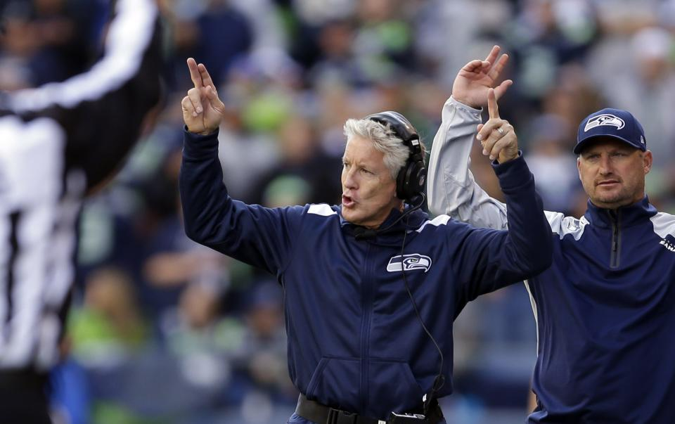 Seattle Seahawks head coach Pete Carroll, center, signals to players in the second half of an NFL football gamea gainst the Jacksonville Jaguars, Sunday, Sept. 22, 2013, in Seattle. (AP Photo/Ted S. Warren)