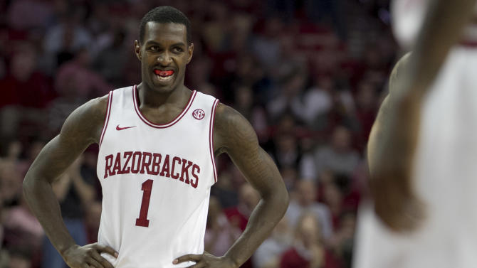 Arkansas' Mardracus Wade (1) smiles after a made free-throw during the first half an NCAA college basketball game against Florida in Fayetteville, Ark., Tuesday, Feb. 5, 2013. (AP Photo/Gareth Patterson)
