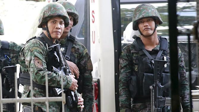 PNP members of the Special Action Force stand guard while waiting for U.S. Marine Lance Corporal Joseph Scott Pemberton who appeared in court in Olongapo city