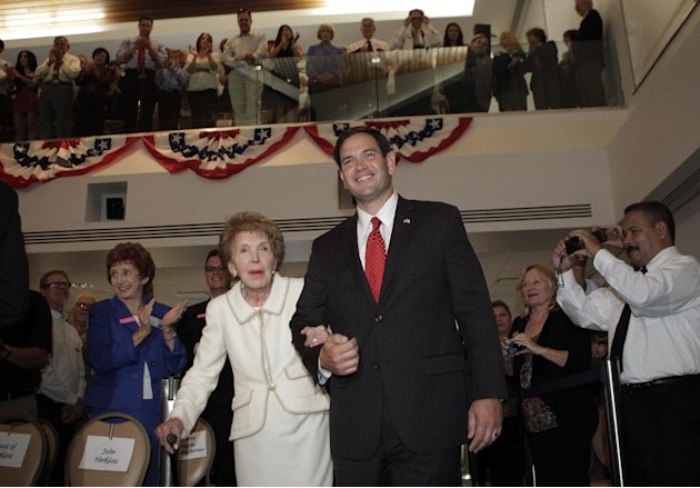 Former first lady Nancy Reagan, left, and Sen. Marco Rubio, R-Fla., arrive for the Reagan Forum at the Ronald Reagan Presidential Library in Simi Valley, Calif., Tuesday, Aug. 23, 2011. (AP Photo/Jae