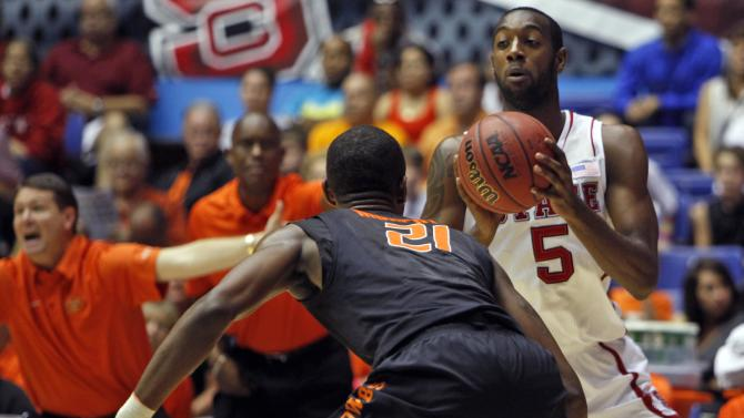 Oklahoma State's Kamari Murphy (21) pressures NC State's C.J. Leslie (5) during a NCAA college basketball game in Bayamon, Puerto Rico, Sunday, Nov. 18, 2012. (AP Photo/Ricardo Arduengo)