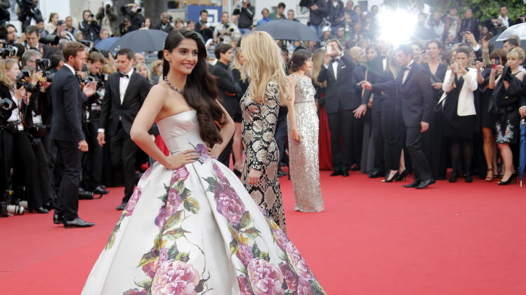Actor Sonam Kapoor, left, poses for photographers as she arrives for the screening of Young & Beautiful at the 66th international film festival, in Cannes, southern France, Thursday, May 16, 2013. (AP Photo/Francois Mori)