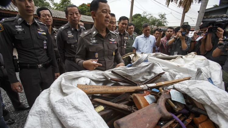 Thai acting national police chief General Watcharapol inspects weapons in Bangkok