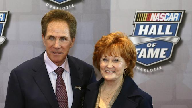 Darrell Waltrip poses for photographers  with his wife, Stevie on the red carpet at the NASCAR Hall of Fame before the start of the Induction Ceremony, Friday, Feb. 8, 2013, in Charlotte, N.C. (AP Photo/Bob Leverone)