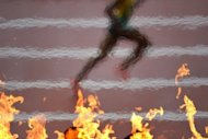 An athlete runs past the Olympic Flame at the London 2012 Olympic Games. An Australian woman has admitted taking the ashes of her late father -- an Olympic silver medallist -- trackside to the London Games and scattering them over the triple jump run-up