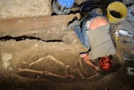 An archaeologist works on the third excavation of a grave inside the medieval Convent of Saint Ursula in Florence on July 17. Archaeologists on Tuesday unearthed a skeleton in a rare state of preservation in Florence in a crucial step towards unravelling the mystery of the identity of the woman with the most enigmatic smile in the world -- the Mona Lisa
