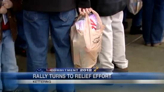 Romney supporters bring canned goods for disaster relief