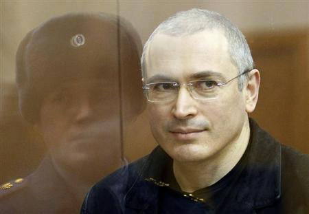 Jailed Russian former oil tycoon Mikhail Khodorkovsky stands in the defendants' cage before the start of a court session in Moscow