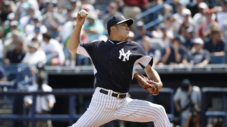 New York Yankees starting pitcher Masahiro Tanaka delivers in the third inning of a spring exhibition baseball game against the Atlanta Braves in Tampa, Fla., Sunday, March 16, 2014