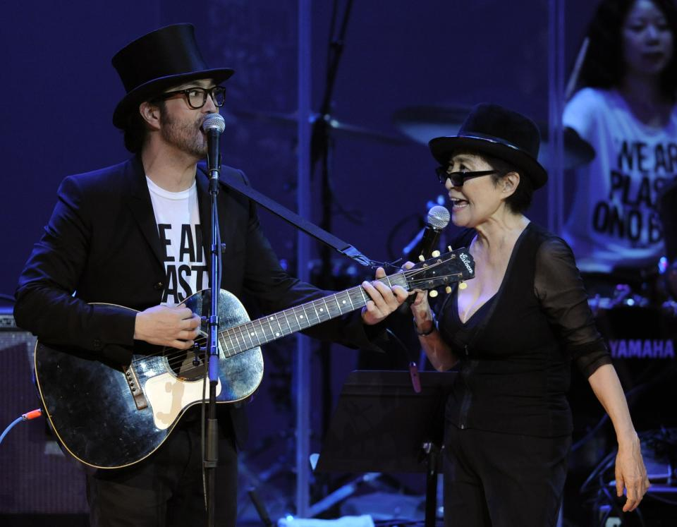 "Yoko Ono, right, performs alongside her son Sean Lennon during the ""Yoko Ono: We Are Plastic Ono Band"" concert at the Orpheum Theater in Los Angeles, Friday, Oct. 1, 2010. (AP Photo/Chris Pizzello)"
