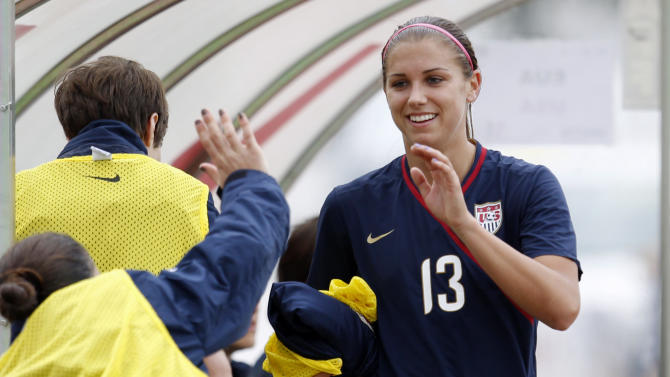 U.S. player Alex Morgan is greeted by teammates on the bench after being substituted during their Algarve Cup women's soccer match with Finland Monday, March 7 2011, in Quarteira, Portugal. Morgan scored twice. (AP Photo/Armando Franca)