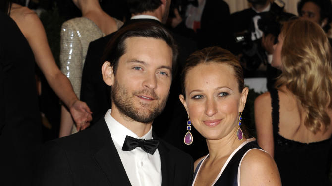 FILE - In this May 7, 2012 file photo, actor Tobey Maguire, left, and his wife Jennifer Meyer arrive at the Metropolitan Museum of Art Costume Institute gala benefit, celebrating Elsa Schiaparelli and Miuccia Prada in New York. Magure attended a fundraiser for President Barack Obama on Thursday, May 10, 2012, hosted by actor-activist George Clooney at his Studio City, Calif., home. (AP Photo/Evan Agostini, file)