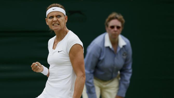 Lucie Safarova of the Czech Republic reacts to breaking serve during her match against Coco Vandeweghe of the U.S.A. at the Wimbledon Tennis Championships in London