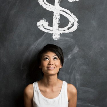 Woman-in-front-of-dollar-sign-on-chalkboard_web