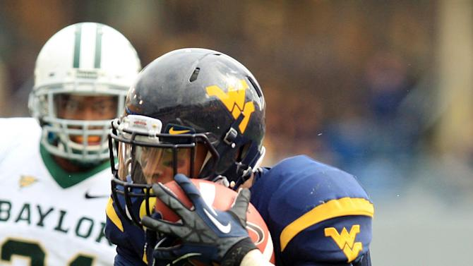 West Virginia receiver Stedman Bailey (3) catches a pass and is tackled by Baylor's K.J. Morton (8) as Baylor's Josh Wilson (21) looks on during their NCAA college football game in Morgantown, W.Va., Saturday, Sept. 29, 2012. West Virginia beat Baylor 70-63. (AP Photo/Christopher Jackson)
