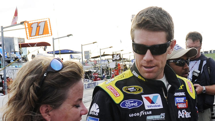Carl Edwards signs autographs before the NASCAR Sprint Cup Series auto race at Atlanta Motor Speedway, Sunday, Sept. 2, 2012, in Hampton, Ga. (AP Photo/David Tulis)