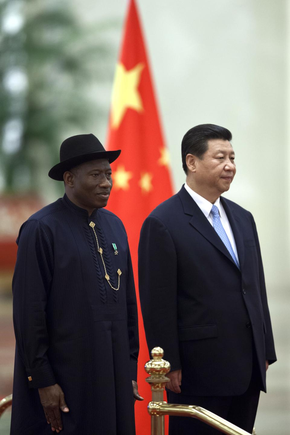 Chinese President Xi Jinping, right, stands with Nigerian President Goodluck Jonathan, left, during a welcome ceremony at the Great Hall of the People in Beijing, China, Wednesday, July 10, 2013. (AP Photo/Alexander F. Yuan)