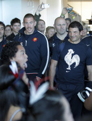 French rugby team coach Marc Lievremont, right, and Imanol Harinordoquy watch performers during a welcome ceremony at Wellington airport, New Zealand, Thursday, Sept. 29, 2011. France will play Tonga in their next Rugby World Cup match on Saturday, Oct. 1. (AP Photo/Christophe Ena)