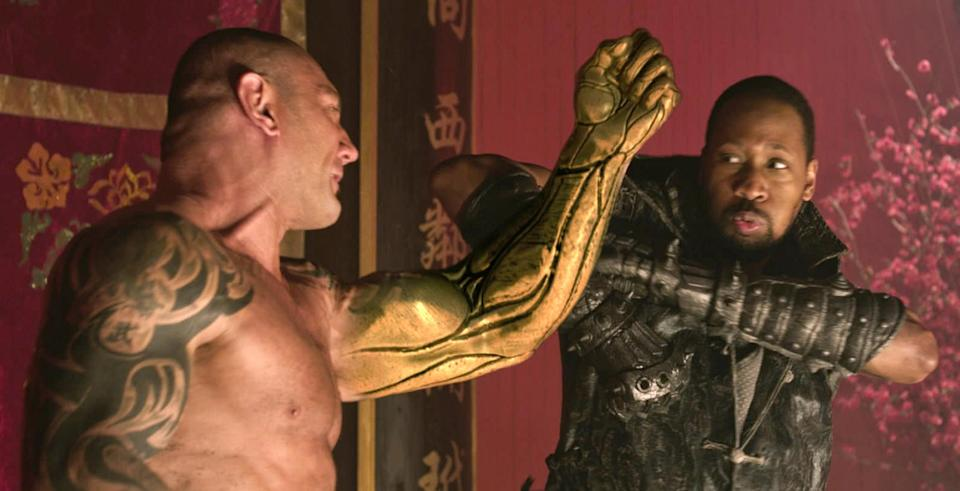 "This image released by Universal Pictures shows actor-director RZA, right, in a scene from ""The Man With the Iron Fists.""  (AP Photo/Universal Pictures)"