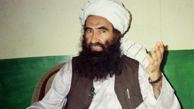 FILE- In this Aug. 22, 1998 file photo, Jalaluddin Haqqani, founder of the militant group the Haqqani network, speaks during an interview in Miram Shah, Pakistan. The U.S. and Pakistan are starting to look more like enemies than friends, threatening the U.S. fight against Taliban and al-Qaida militants based in the country and efforts to stabilize neighboring Afghanistan before American troops withdraw.(AP Photo/Mohammed Riaz, File)