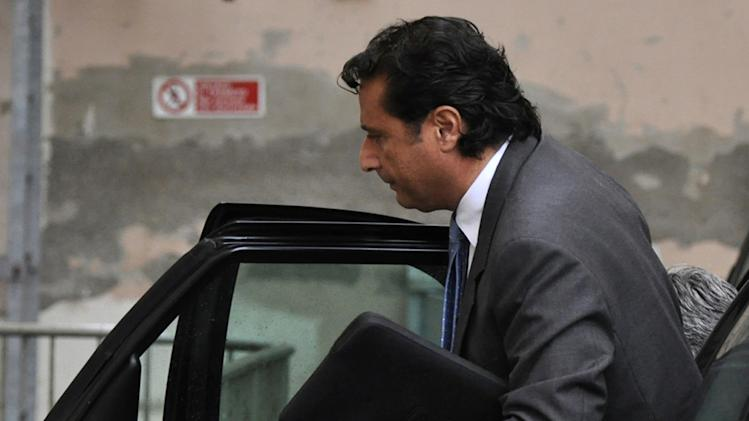 Francesco Schettino, the captain, arrives to attend the trial where he is accused of alleged manslaughter, abandoning ship and causing the shipwreck of the Costa Concordia near the Tuscan island of Giglio in January 2012, in Grosseto, Central Italy, Monday, Nov. 11, 2013. Stefano Iannelli, crewman-in-training, testified Monday that Schettino jumped, shortly before he himself did, onto the roof of a lifeboat. Iannelli said he didn't see any passengers still aboard. However, hours after Schettino abandoned ship, helicopters rescued people from the capsized vessel. (AP Photo/Giacomo Aprili)