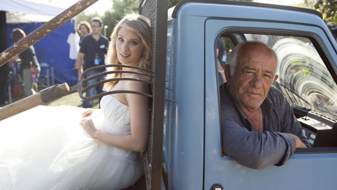 """In this photo released Wednesday, May 9, 2012 by Bell Phillip Television Productions Inc., Kim Matula, left, who plays Hope, sits on a small truck during the shooting of TV soap opera """"The Bold and the Beautiful"""", in Masseria San Domenico, Italy, Sunday, May 6, 2012. (AP Photo/Damiano Guberti, Bell Phillip Television Productions, Inc.)"""