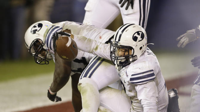 Brigham Young linebacker Kyle Van Noy scores on a recovered fumble which he caused when he hit San Diego State quarterback Adam Dingwell in the end zone during the fourth quarter of the Poinsettia Bowl NCAA college football game Thursday, Dec. 20, 2012, in San Diego. BYU won the game 23-6. (AP Photo/Lenny Ignelzi)