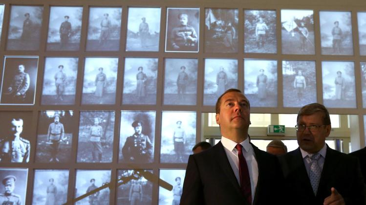 Russian Prime Minister Dmitry Medvedev, second right, visits the Look into the Eyes of War exhibition marking the 100th anniversary of World War I in Moscow, Russia, Thursday, Aug. 28, 2014. (AP Photo/RIA-Novosti, Yekaterina Shtukina, Government Press Service)