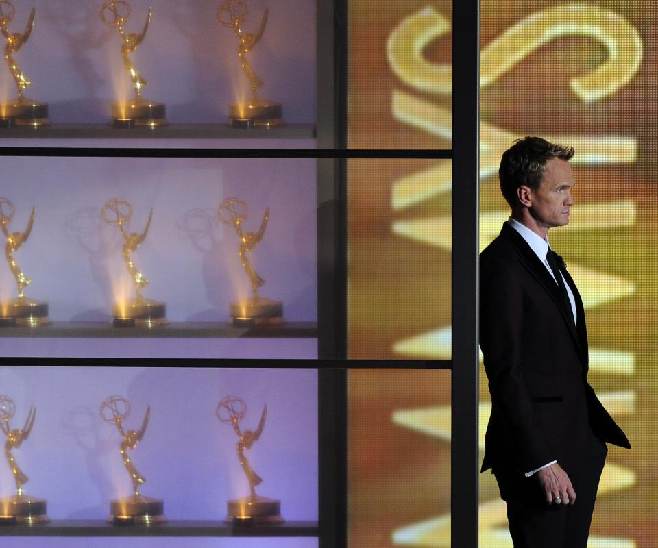 Host Neil Patrick Harris appears on stage at the 65th Primetime Emmy Awards at Nokia Theatre on Sunday Sept. 22, 2013, in Los Angeles. (Photo by Chris Pizzello/Invision/AP)