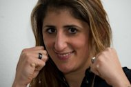 Germany&#39;s former boxing world champion Rola El-Halabi poses for photographers after a press conference in Ulm. El-Halabi is set to fulfil her dream in January to box again, nearly two years after she was gunned down by her stepfather in a vicious attack