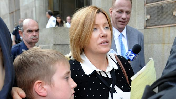 Anna Gristina exits Manhattan criminal court with her son Nicholas in New York on Tuesday, Sept. 25, 2012. The suburban mother of four charged with moonlighting as a multimillion-dollar madam pleaded guilty Tuesday to promoting prostitution. The judge said she'll be sentenced on Nov. 20, 2012 to time served and probation as part of a plea deal. (AP Photo/Louis Lanzano)