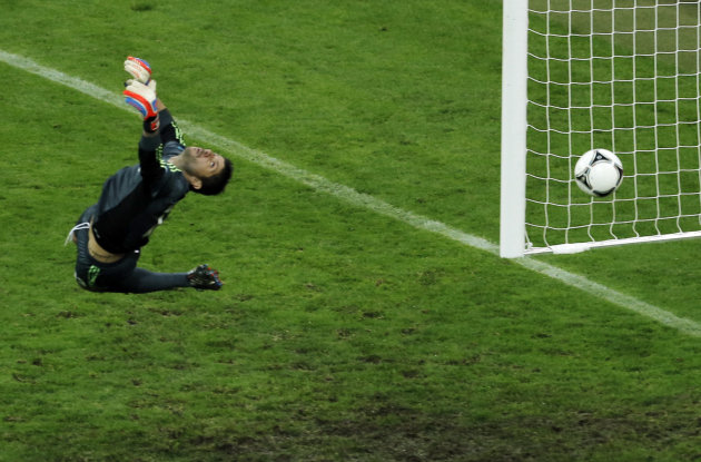 Greece goalkeeper Michalis Sifakis fails to make a save as Germany's Philipp Lahm, unseen, scores the opening goal during the Euro 2012 soccer championship quarterfinal match between Germany and Greec