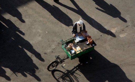 <p>An Egyptian street vendor waits for customers at Cairo's landmark Tahrir Square. The United States is weighing a deal with Egypt's new rulers to relieve $1 billion worth of debt, The New York Times reported.</p>