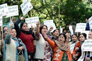 Activists from India's main opposition Bharatiya Janata Party (BJP) shout anti-government slogans as they demand the resignation of the Delhi chief minister during a protest in the capital on December 19, 2012. They were demonstrating over the gang-rape of a 23-year-old student on a bus