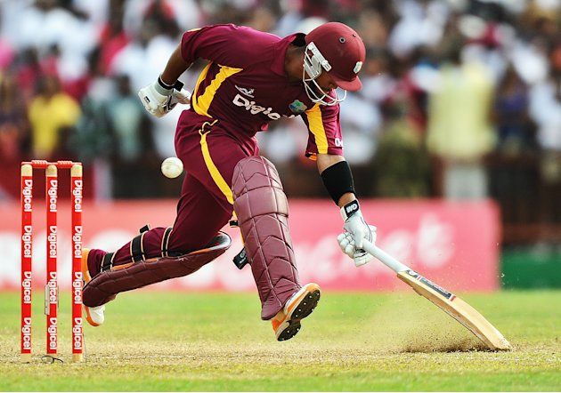 West Indies cricketer Carlton Baugh take