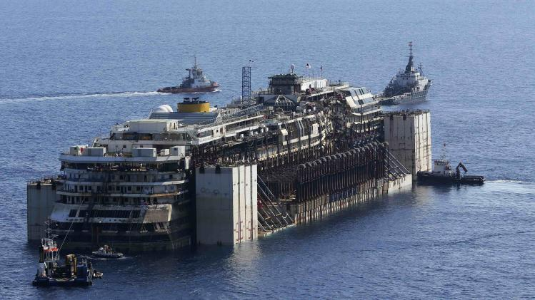 Tugboats move the cruise liner Costa Concordia anticlockwise during the refloat operation maneuvers at Giglio Island