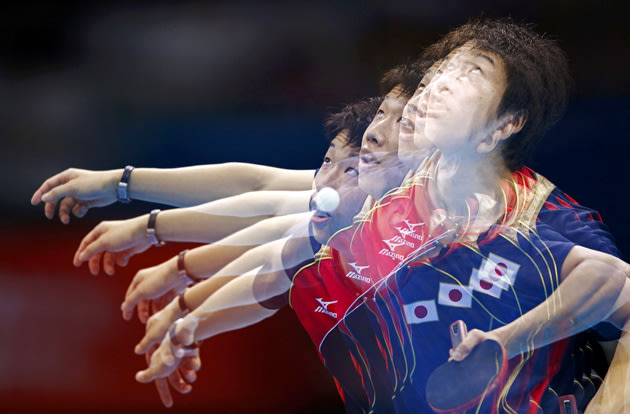 Japan's Jun Mizutani serves to Hong Kong's Leung Chu Yan in their men's team quarterfinals table tennis match at the ExCel venue during the London 2012 Olympic Games