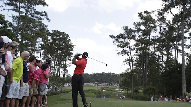Tiger Woods hits from the fifth tee during the final round of The Players championship golf tournament at TPC Sawgrass, Sunday, May 12, 2013, in Ponte Vedra Beach, Fla.  (AP Photo/John Raoux)