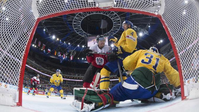 Austria's Raffl challenges Sweden's goaltender Nilsson and Kronwall during their Ice Hockey World Championship game at the O2 arena in Prague