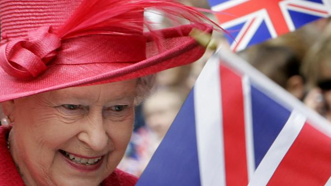 FILE - In this April 21, 2006 file photo, Britain's Queen Elizabeth II meets the public during a walkabout to celebrate her 80th birthday in Windsor, England. In the next four days, the normal ebb and flow of British life will give way to a series of street parties, flotillas, outdoor concerts and finally the appearance of an elderly great-grandmother on her balcony to wave to her subjects. The pageantry is very grand and very British. But at the heart of the Diamond Jubilee celebration is a nearly universal sense of appreciation for the reign of Queen Elizabeth II, who is marking 60 years on the throne. (AP Photo/Kirsty Wigglesworth, Pool)