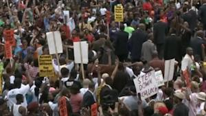 Hundreds march in Ferguson to protest police shoot…