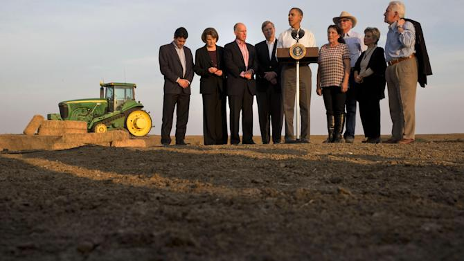 ** ADDS NAME OF PERSON AT FAR LEFT ** President Barack Obama, center, speaks about the drought after touring a local farm in Los Banos, Calif., Friday, Feb. 14, 2014, as from left, Michael Connor, commissioner of bureau of reclamation Sen. Dianne Feinstein, D-Calif., Calif. Gov. Jerry Brown, Agriculture Secretary Tom Vilsack, Obama, Maria Gloria Del Bosque of Empresas Del Bosque, Inc., Joe Del Bosque of Empresas Del Bosque, Inc., Sen. Barbara Boxer, D-Calif., and Rep. Jim Costa, D-Calif., listen. (AP Photo/Jacquelyn Martin)